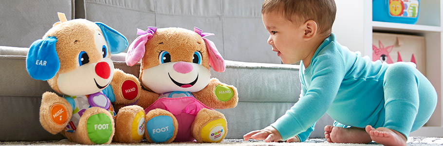 photo of baby smiling at Laugh & Learn® toys