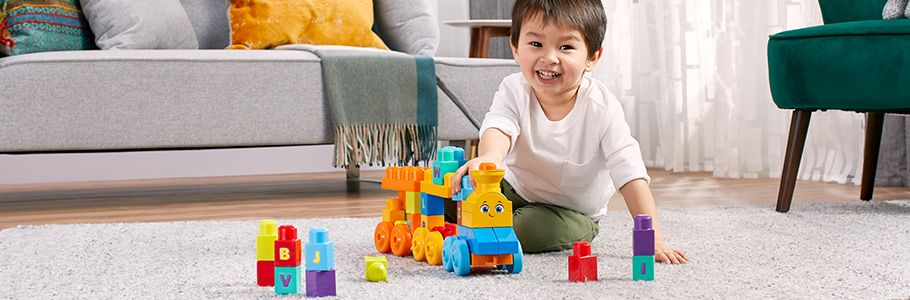 little boy playing with Mega Bloks®