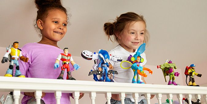 image of little girls playing with Rescue Heroes figures