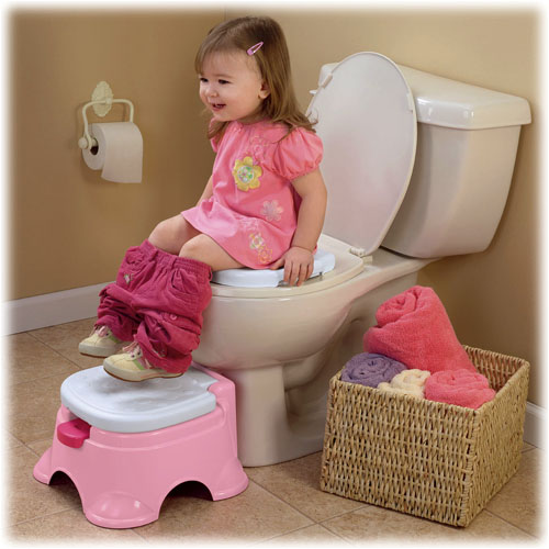 Potty ring removes for use on a regular toilet seat