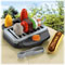"Includes grill with ""glowing"" charcoal,  ""magic"" hot dog with bun, mustard & ketchup bottles, tongs, kabob skewer, meat, shrimp, green & red peppers and mushroom & onion slice."